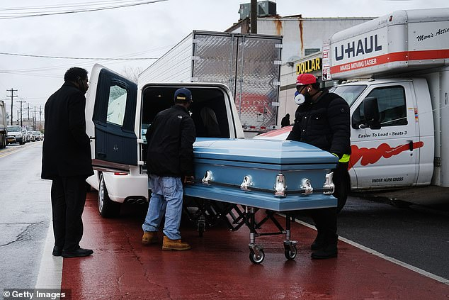 Scientists say it is 'troubling' to see so many Americans die in an era where modern medicines, such as ventilators, are less available than in 1918.  Pictured: A coffin is carried on a chariot from the Andrew Cleckley Funeral Home in Brooklyn, New York, April 2020