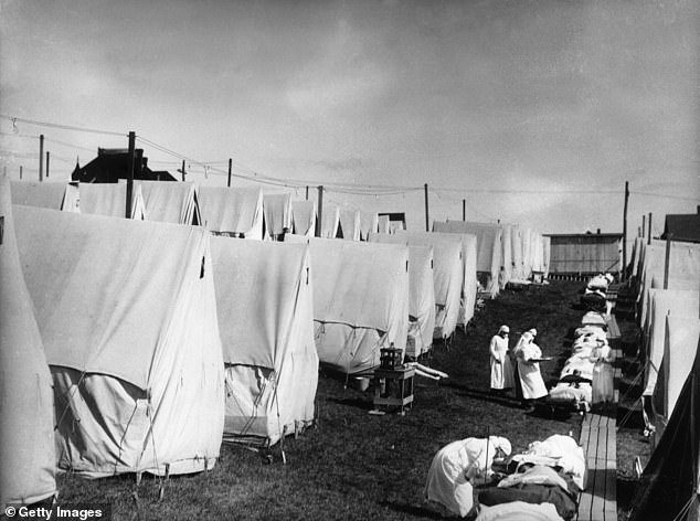 About half the black population was unaccounted for when the mortality figures were calculated in 1918, suggesting that deaths from the black Spanish flu had been underestimated.  Image: Nurses care for victims of the Spanish flu pandemic outside in Lawrence, Massachusetts, 1918