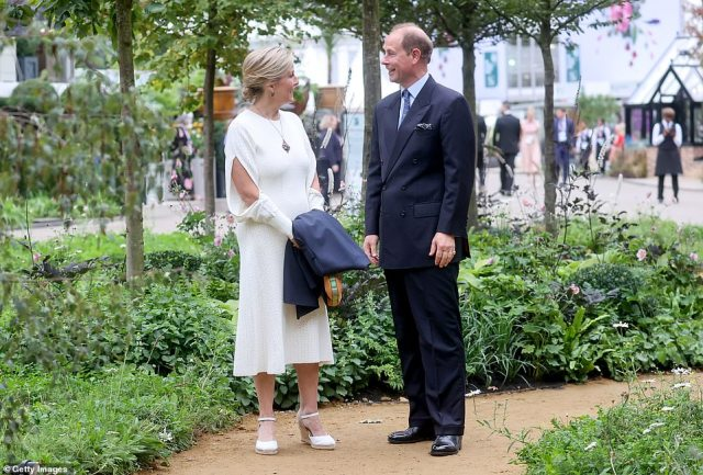 Sophie looks like the essence of summer chic in her white number as she smiled at her husband Prince Edward today