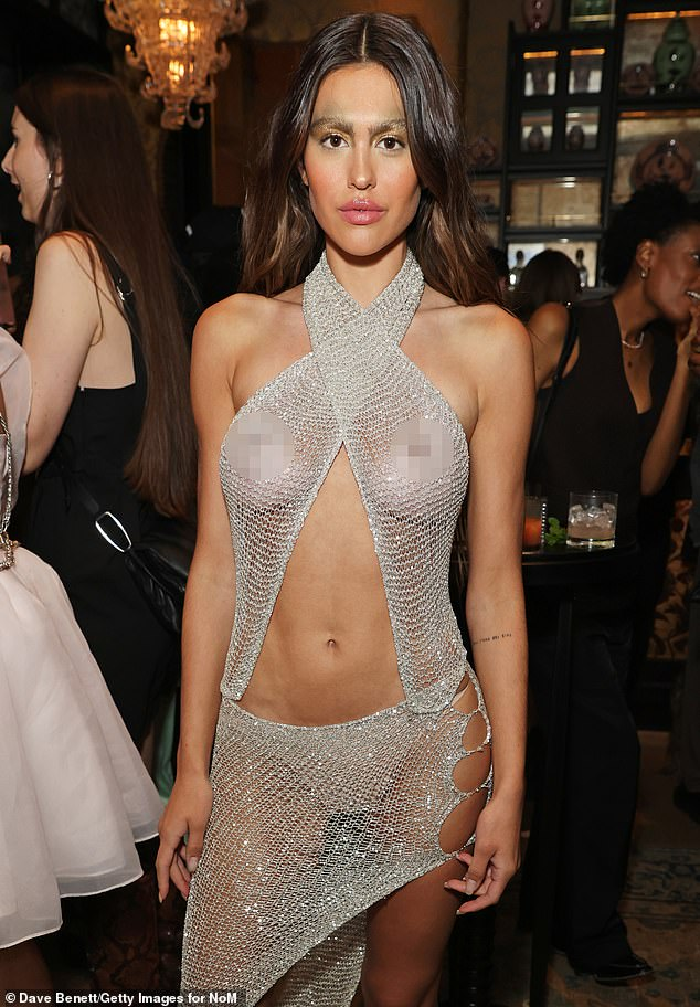 Show off: Amelia Hamlin apologized to her famous father Harry Hamlin after going nearly naked during a party at London Fashion Week