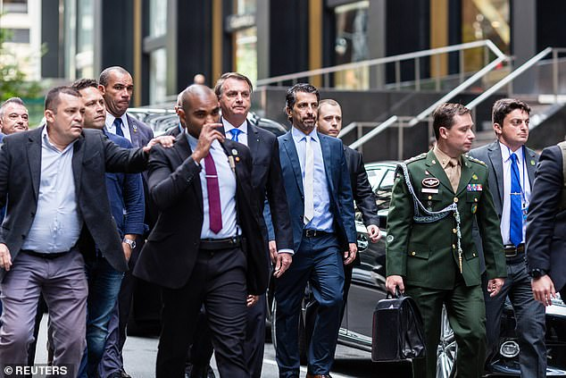 Bolsonaro, who claims he is unvaccinated against coronavirus , and his ministers had pizza slices and sodas in the middle of the street on Sunday as they arrived in-person for the United Nations General Assembly meeting