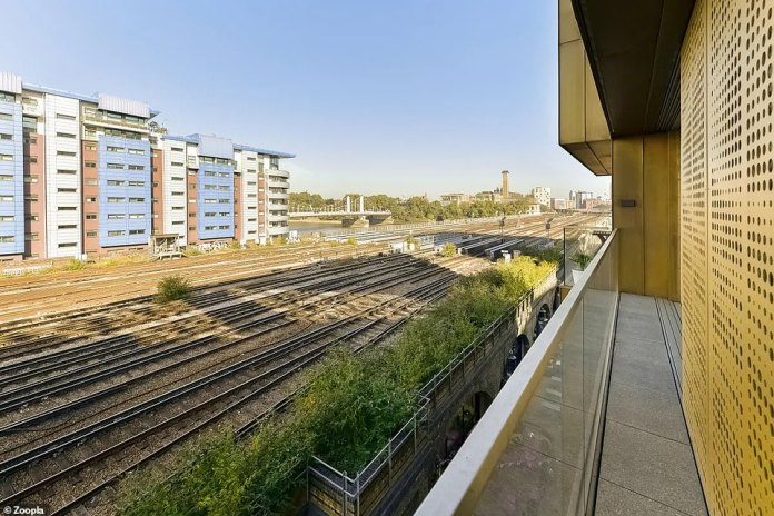 There is also a small balcony at the rear of the flat that overlooks the railway tracks carrying passengers in and out of central London.