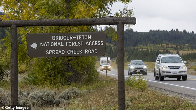 A sign leads the way to Spread Creek Campground in Wyoming where a body 'consistent with the description' of Petito was found by the FBI