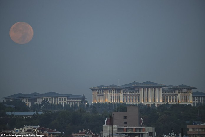 The Harvest Moon is seen along the Presidential Complex in Ankara, Turkey.  The Harvest Moon can occur at any time from a fortnight to a fortnight before the autumnal equinox and is either the last full moon of summer, or the first full moon of autumn.