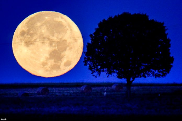 The full moon is located behind the hills of the Taunus region near Wehrheim, Germany.  On average, the moon rises 50 minutes after sunset each day, but when it's an equinox moon, it can rise as little as 25 minutes after sunset.