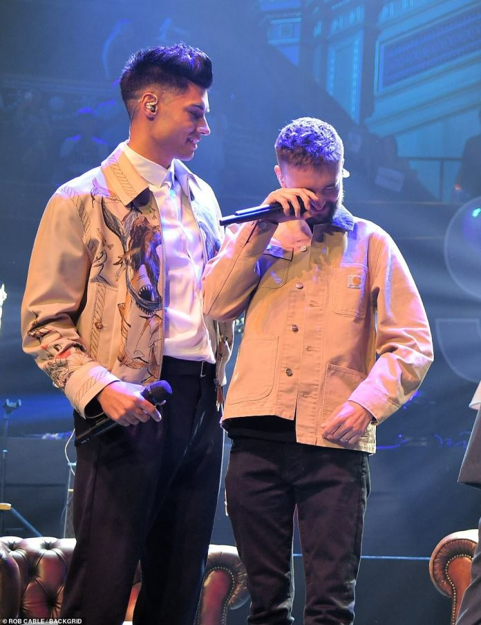 SUPPORT: Tom Parker gets emotional as he performs with his band The Wanted for the first time in seven years for his In My Head charity concert at the Royal Albert Hall on Monday (pictured with Siva Kenswaren)