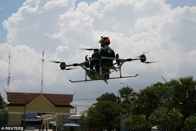 With eight propellers and using a school chair for the pilot's seat, the drone was developed by students from the National Polytechnic Institute of Cambodia (NPIC) on the outskirts of the capital.