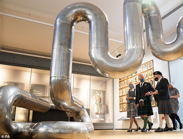 The couplelooked to be in jovial spirits as they gazed around the one of the finest collections of art in the UK