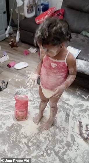 One of his daughters covered in flour