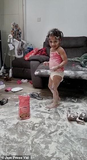 Older sister Nalah covered in flour