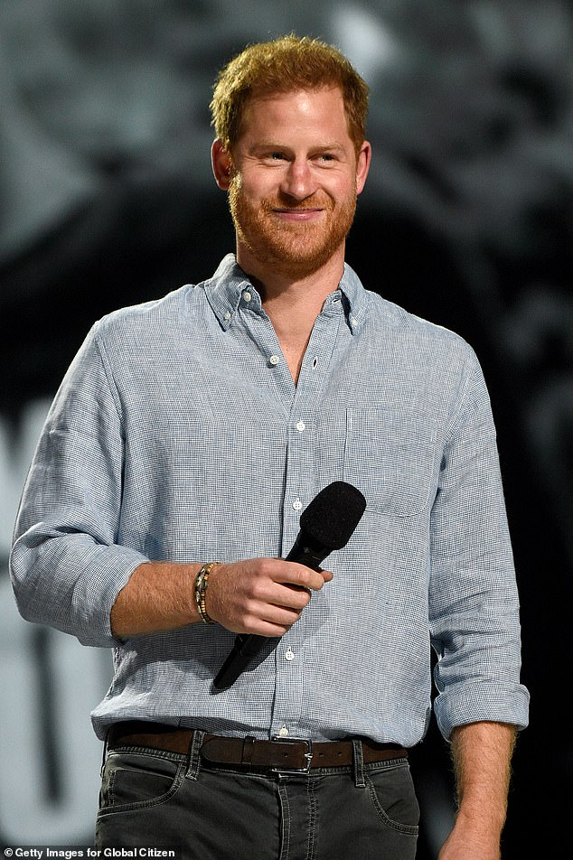 Prince Harry's name was in the spotlight as he was greeted by wild cheers and an enthusiastic crowd standing by during a speech at a Global Citizen star-studded concert in Los Angeles in May (pictured)