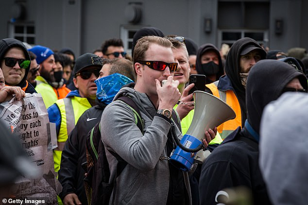 A major force behind the anti-lockdown protests that have ripped through Melbourne in recent weeks is a 24-year-old IT guru you'd never suspect
