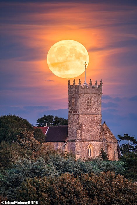 Landscape photographer Jamie Russell captured the Harvest Moon rising above All Saints Church in the parish of Godshill on the Isle of Wight