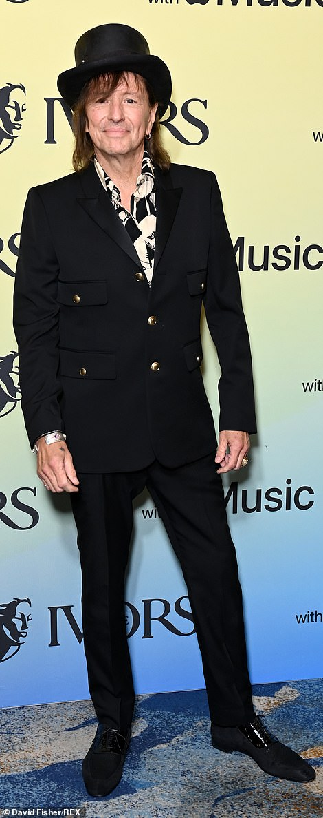 rock on!  Bon Jovi star Richie Sambora, 62, looked like rock royalty in a stylish black number with a top hat