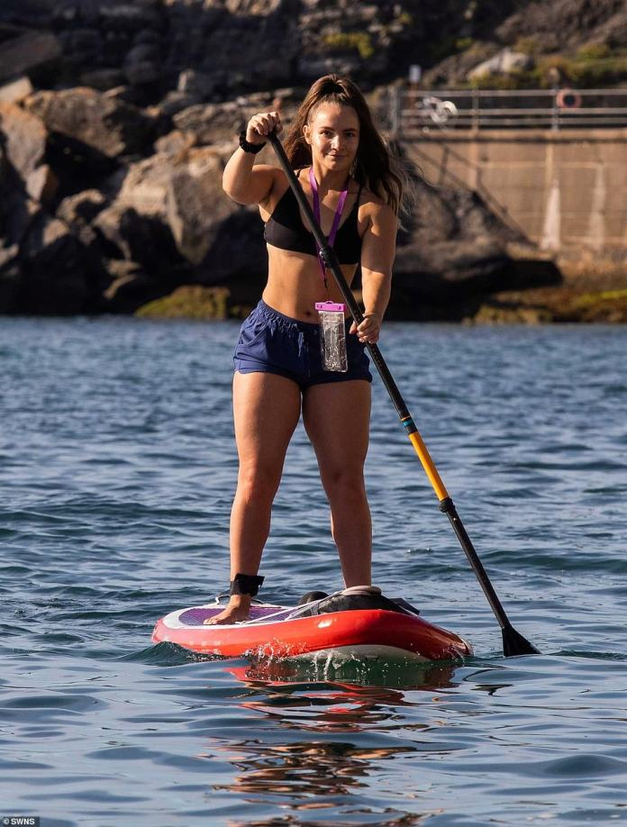 Naomi Prosser aged 28, enjoys the sea and sunshine in Torbay, Devon, as Britons make the most of the warm temperatures on the last day of summer