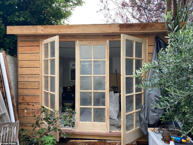 A key feature of the shed office are the impressive doors, which Jonathan found on Facebook Marketplace for less than what they would have cost in store