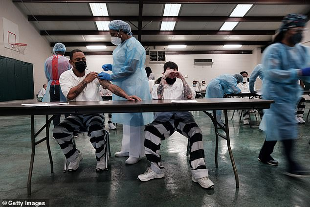 A new CDC report looks at a Delta variant outbreak in a Texas prison in the summer of 2021, seeing 172 inmates infected with COVID-19, 75% of whom were fully vaccinated.  Pictured: Inmates at the Bolivar County Correctional Facility in Cleveland, Mississippi, receive COVID-19 vaccines in April 2021