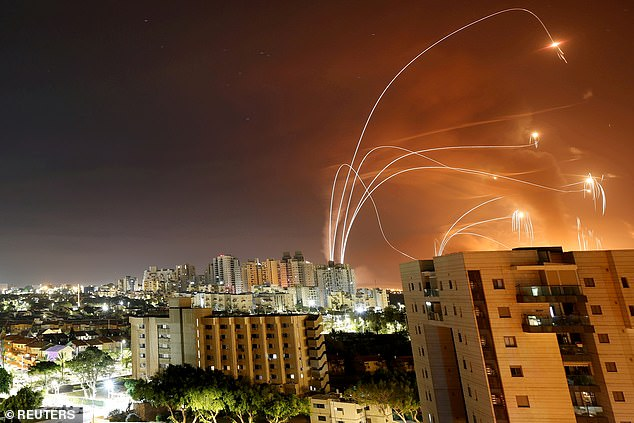 Stripes of light are seen as Israel's Iron Dome anti-missile system intercept rocket launched from the Gaza Strip