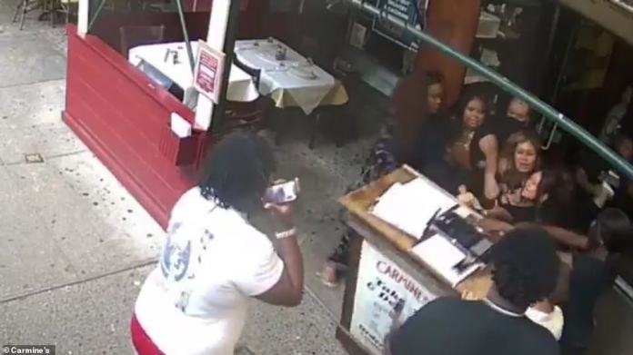 The other women also confront the server, while her coworker appears to try to guide her away from the diners before a fight breaks out