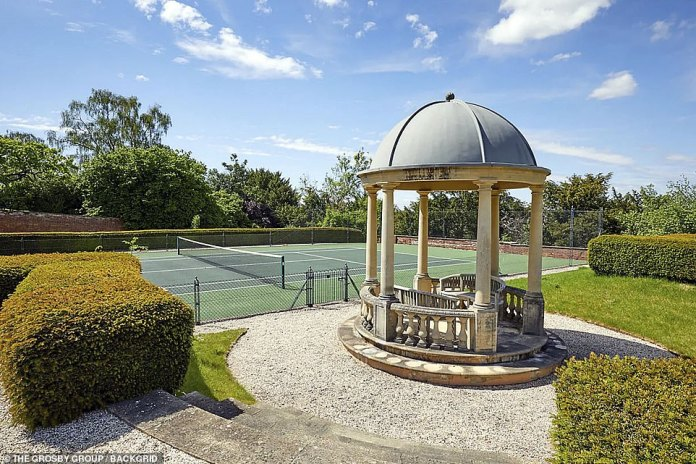 Quiet: The property has a walled garden with a pavilion, a tennis court and paddock for horses