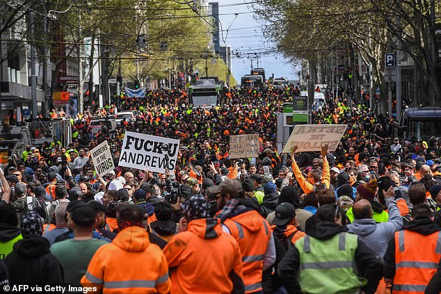 About 2,000 angry protesters took to the streets (pictured on Tuesday) to oppose mandatory Covid vaccinations on work sites - with unions insisting many weren't tradies but 'far-right opportunists'