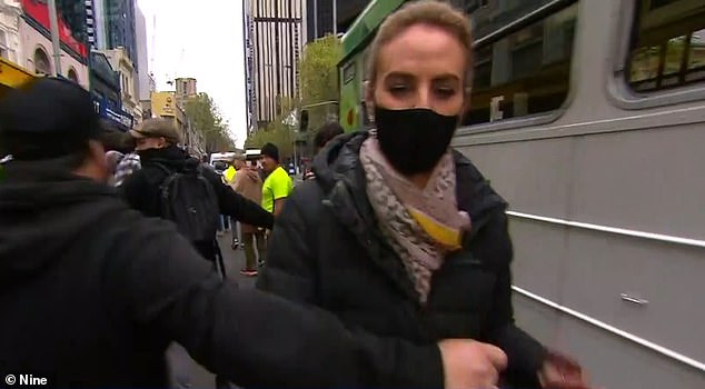 Grabbed:Channel Nine reporter Christine Ahern was harassed by demonstrators on Wednesday when she tried to provide an update on the scene in Melbourne's CBD