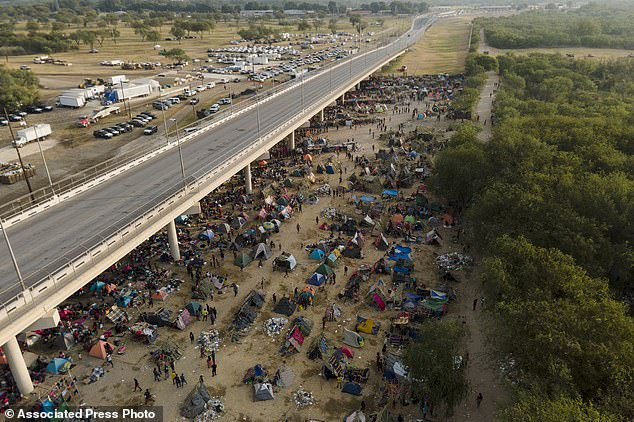Thousands of Haitian migrants are seen in the makeshift camp under the Del Rio bridge in Texas Tuesday awaiting processing
