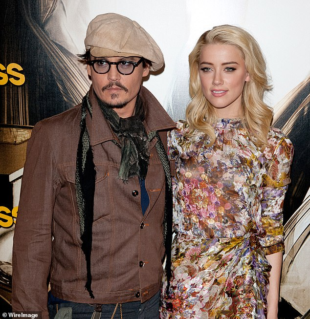 Legal case: Depp has won the right to sue Heard (pictured in November 2011) in a $50 million libel case after a Virginia judge threw out the actress's plea to dismiss the suit