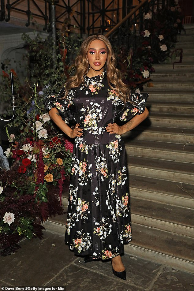 Beauty: Monroe Bergdorf showed confidence in a black floral maxi dress posing with hands-off hips that showcased her edgy frame.