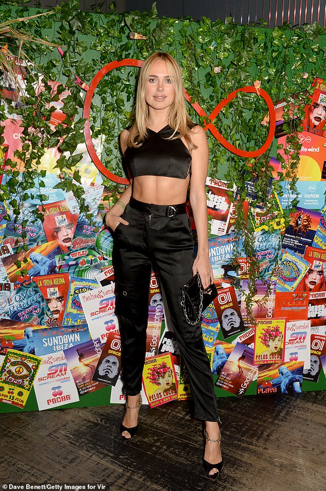 Beauty: Kimberly Garner meanwhile looked sensational as she displayed her toned waist in a black bandana and matching trousers