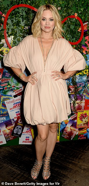Sensational: The Pussycat Dolls' Kimberly Wyatt kept her hands on her hips as she showed off her slim waist in a cream puff mini dress