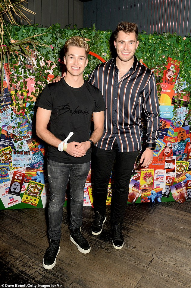 Brothers: AJ and Curtis Pritchard appeared in high spirits, while each donned a coordinating pair of white-soled midnight trainers