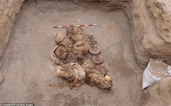 Peruvian workers laying gas pipes found remains of a variety of wind instruments, including corns, dishes, and flutes placed around the carcass