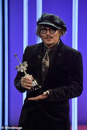 Trophy: Depp receiving his Donastia Award on Wednesday