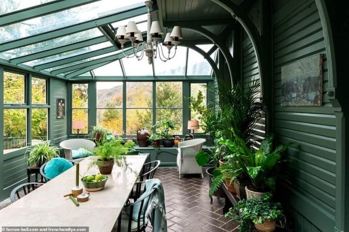 Owners Stuart and Kathy Morgan paid £355,000 for the property in 2002 and additional rooftop jean sits, which have been given a facelift by the owners with the help of upmarket paint company Farrow & Ball to give the interior a facelift .