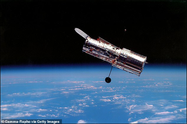 The discovery was made by NASA's Hubble Space Telescope (pictured) in conjunction with the Atacama Large Millimeter/submillimeter Array (ALMA) in Chile.