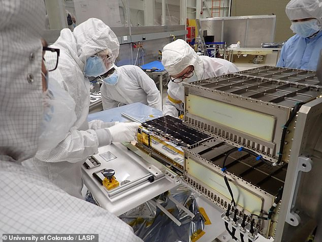 The CubeSat will go into space on September 27 on a Joint Launch Alliance Atlas V rocket with the Landsat 9 satellite.  Pictured is a team installing CUTE in their launch system.