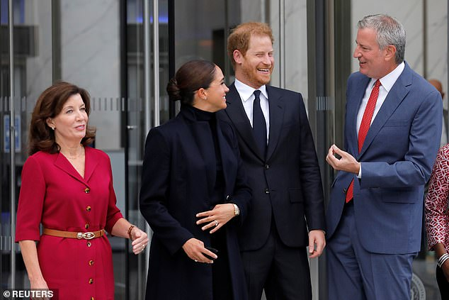 New York Governor Kathy Hochul and New York City Mayor Bill de Blasio stand with Britain's Prince Harry and Meghan, Duke and Duchess of Sussex, while visiting One World Trade Center in Manhattan