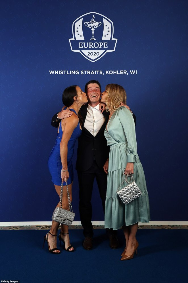 There was one star of Team Europe who turned up in America without a partner to cheer him on. Luckily for single Viktor Hovland, 24, two teammates' WAGs made sure he didn't feel left out. Angela Akins Garcia and Emma Lofgren posed with the Norwegian during the photocall for couples. He beamed a huge smile as the pair planted a kiss on each of his cheeks. The partners of two other players in the team, Matt Fitzpatrick and Bernd Wiesberger, did not go to the dinner.
