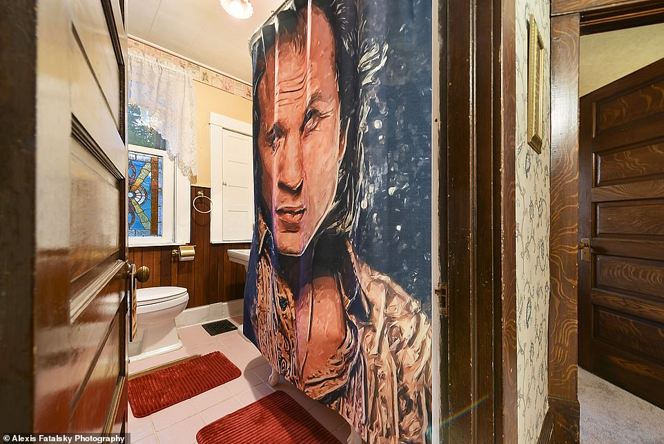 He's watching you: The bathroom has a creepy Buffalo Bill shower curtain and red rugs