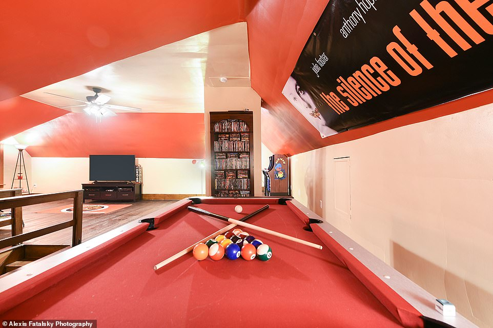 Friendly competition: The room also boasts a pool table that doubles as an air hockey table