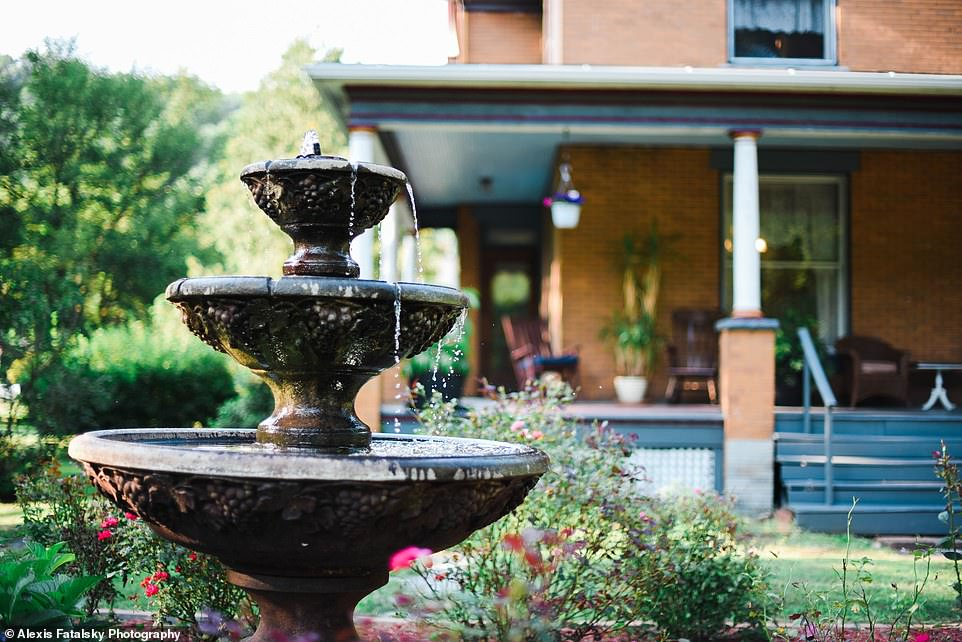 How pretty: The home hasa rose bed garden and fountain out front, one of the first things guests see when they pull up