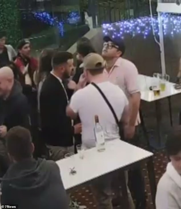 Mr McAlister (pictured in a pink shirt) sparked a pub brawlthe Glasgow Arms Hotel in Ultimo in June last year after punching Leo Rivaud in the face (pictured in a black jacket)