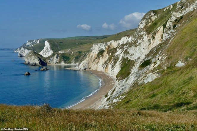 So those hoping for one final dose of vitamin D need to head out and make the most of this weekend. Pictured: The stunning Jurassic coastline looking out to Durdle Door, Oswald's Bay and Bats Head taken from Dungy head on Wednesday