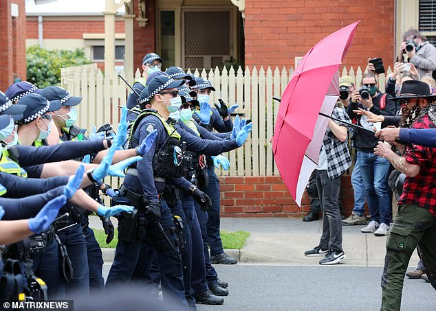 Victoria Police arrested 215 protesters throughout the day while two officers suffered head injuries, and one was taken to hospital with chest pains
