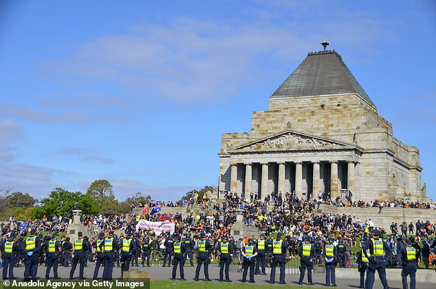 Construction workers furious over mandatory coronavirus vaccine requirements on job sites protested at Melbourne's war memorial (pictured on Wednesday)