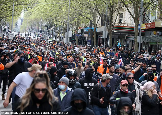 Protesters marched around Melbourne's CBD for hours on Tuesday. Pictured are demonstrators on Wednesday