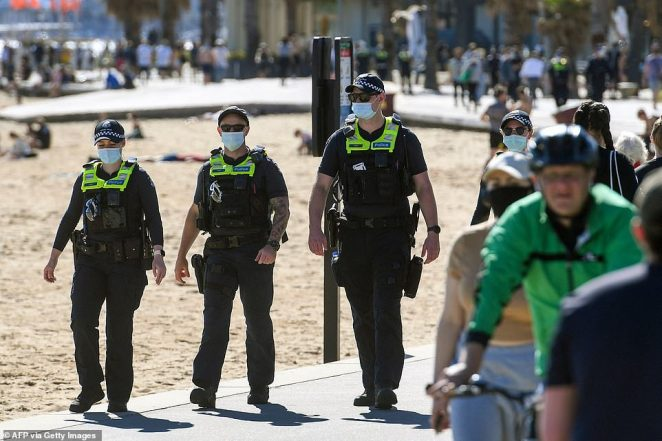 Victorian police officers (pictured) patrolled the beach front and streets of St Kilda after rumours large-scale protests would be occurring in the area and around Melbourne's CBD