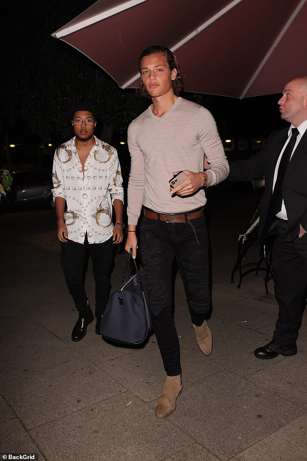 Going out: Jade Goody and Jeff Brazier's son, 18, showcased his model in a trendy skin-tight beige sweater as he left with friends