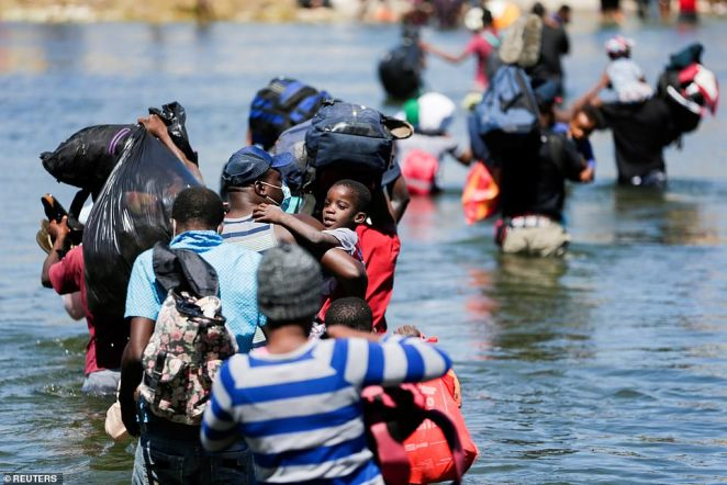 People continued to make the crossing into the United States on Thursday, wading through the Rio Grande River from Ciudad Acuna in Mexico towards Del Rio Texas